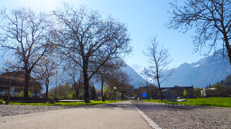 Walking street at the Interlaken park with blue sky background Stok Fotoğraf