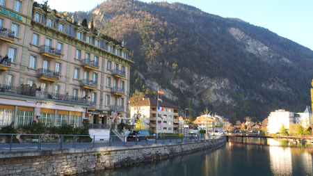 River run through Interlaken town with mountain background