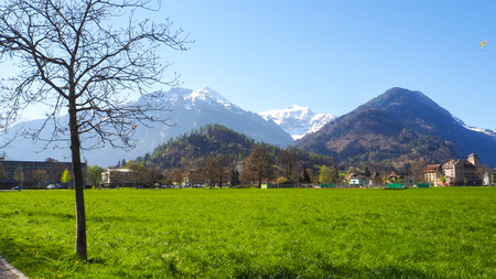 Interlaken Park with snow mountain and blue sky background