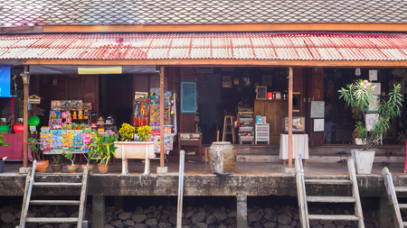 Old house style shop along canal at Ampawa Editorial