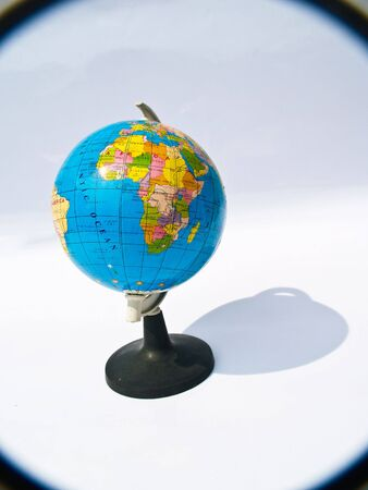 globe  magnifying glass photo