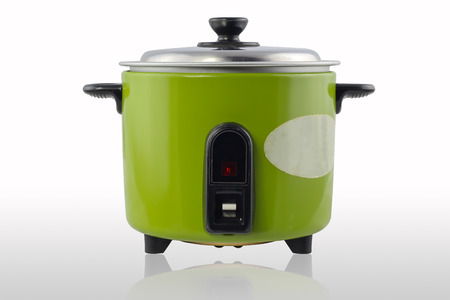 crock pot: Green electric cooker on white background
