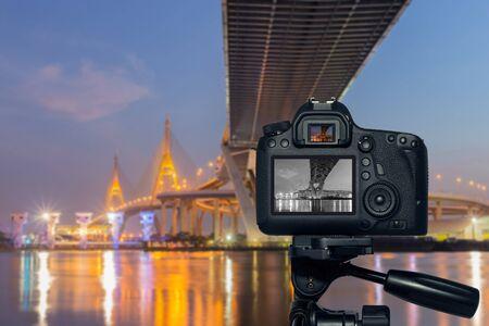 bhumibol: DSLR camera on tripod monochrome shooting Bhumibol Bridge at twilight