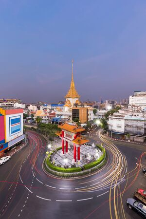 wat traimit: Traffic in Royal Jubilee Gate, Landmark of Chinatown and Wat Traimit Temple of the Golden Buddha , Bangkok, Thailand. Landmark of Chinatown in Yaowarat Road Odeon Roundabout