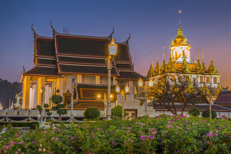 Wat Ratchanatdaram a Beautiful temple at twilight time, the temple is best known for the Loha Prasat famous landmark for tourist in Bangkok,Thailand