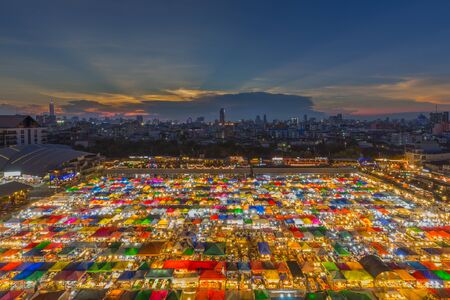 The Train night market Ratchada at Bangkok Thailand in sunset.