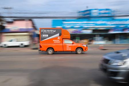 The Kerry express logistic truck running on street for send box to customer on June,08,2018 at Bangkradi Road,Bangkok,thailand.