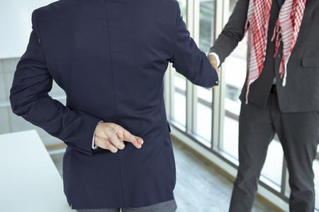 Arabian business  shaking hand with lie sign Reklamní fotografie