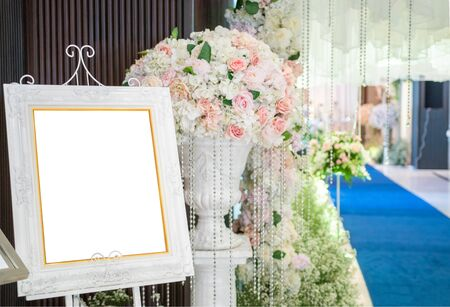 Photo frames and flower arches in front of the wedding