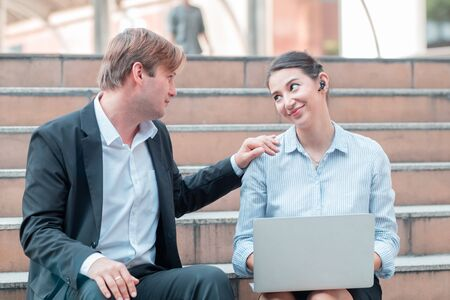 Business people smile and look at each other's eyes While helping each other work and encourage each other Stock fotó