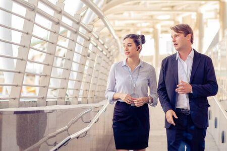 Business men talk to business women While walking and resting on the Skywalk, Teamwork, partnership concep Reklamní fotografie