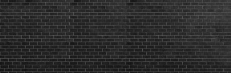 dark black grey brick wall , wide panorama of masonry ,panaromic hight resolution photo. Reklamní fotografie