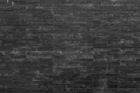 panorama black brick wall of dark stone texture and background