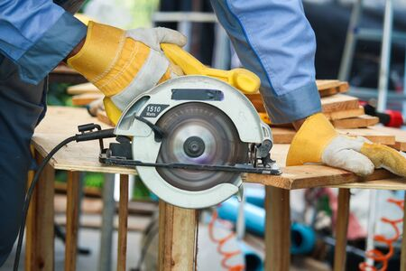 Close-up  of workers being used Circular saw Saw to cut the sheet wood