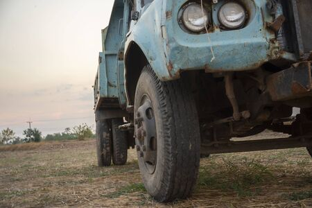 Old truck parked in rice fields in Thailand