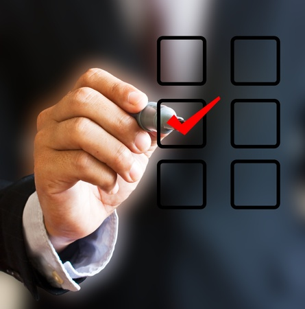 Hand with pen and check box. Stock Photo