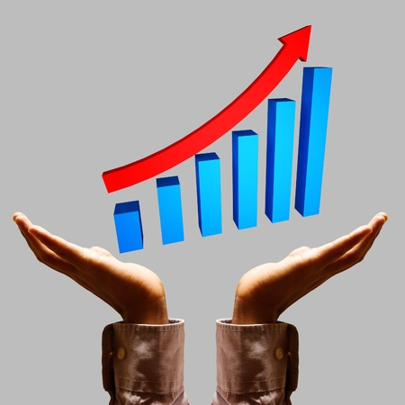 Businessman hand and graphs. photo