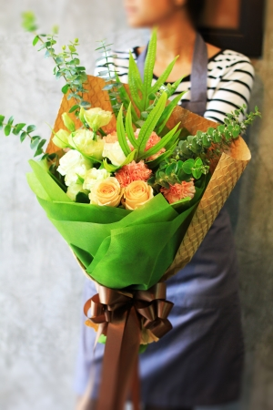 Florist holding bouquet photo