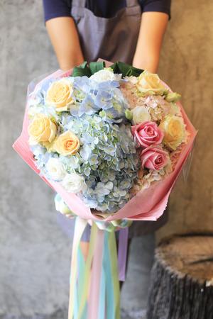 Florist holding bouquet photo