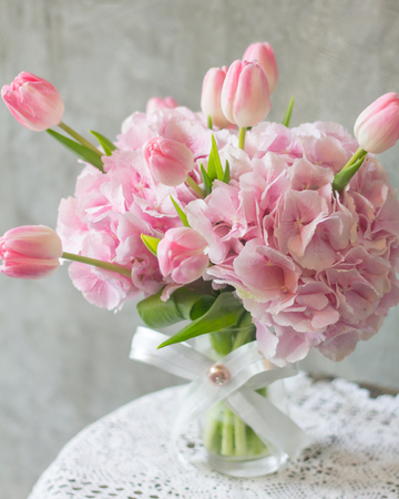 bunch of flowers: Pink flowers in vase isolated.