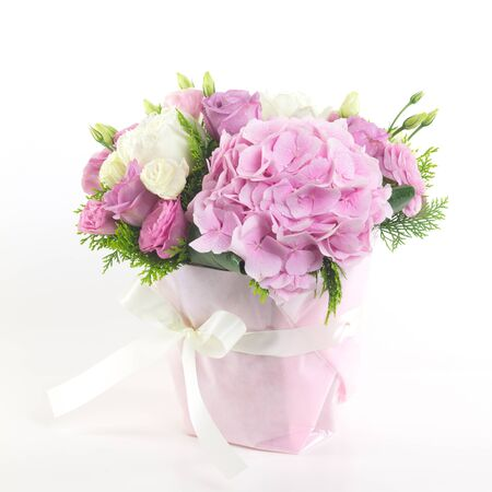 beautiful flowers: Beautiful flowers in basket isolated. Stock Photo