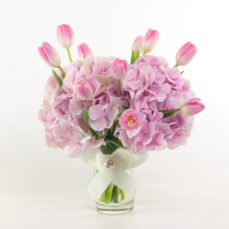 vase: Pink flowers in vase isolated.