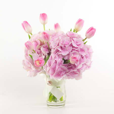 flowers in vase: Pink flowers in vase isolated.