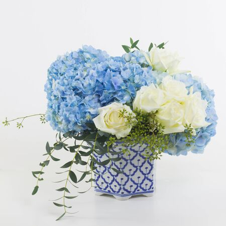 isolated flower: Flower bouquet in vase isolated.