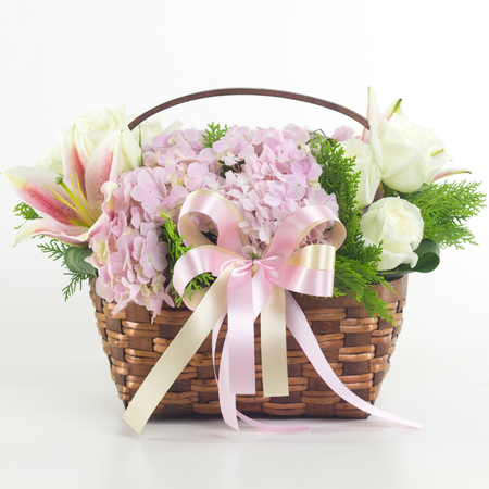 Beautiful flowers in basket isolated. Stock Photo