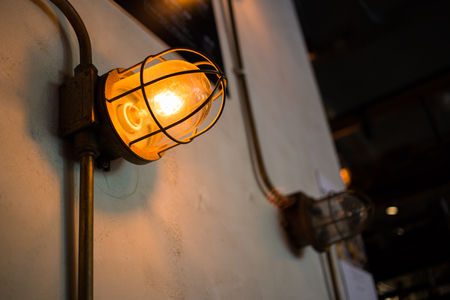 caged: Vintage caged inspection lamp ideal for contemporary interior light, featuring metal cage, glass dome,