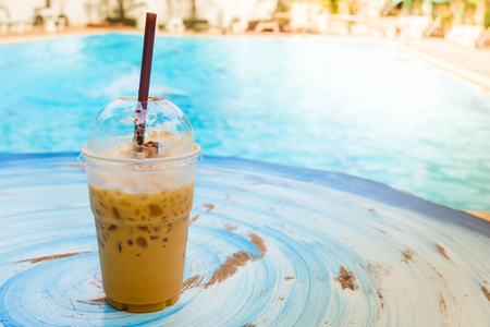 fredo: iced coffee with swimming pool Archivio Fotografico