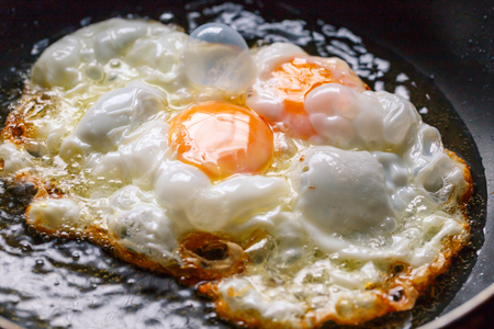 Cooking fried egg blur