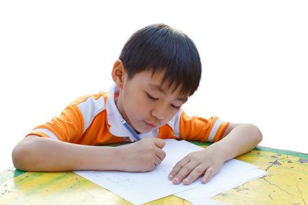 Boy drawing on a table Reklamní fotografie