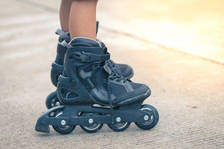Closeup inline roller skate on the leg detail art