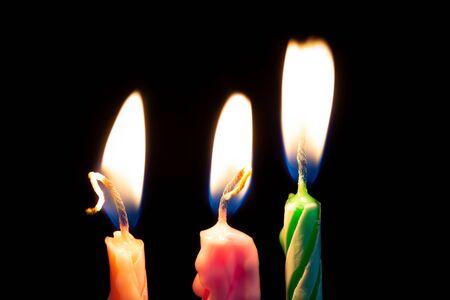 Three birthday candles on black background detail art 版權商用圖片