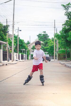 Asian boy is playing roller skate detail Stockfoto