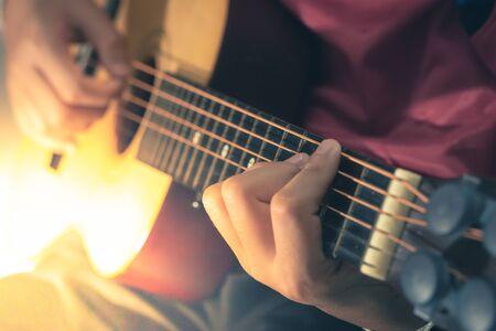 Man playing an acoustic guitar detail blur art