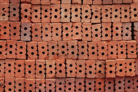 Stack the red bricks that are arranged in the background for construction detail