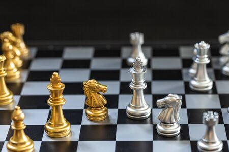 Chess game, set the board waiting to play in both gold and silver pieces detail blur Stok Fotoğraf