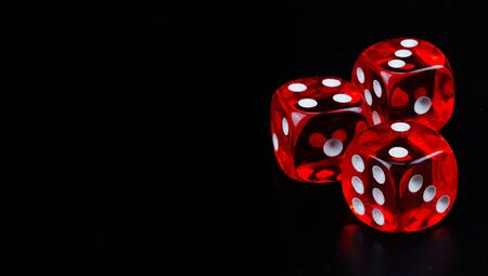 Red dice in dark black background detail object art Banque d'images