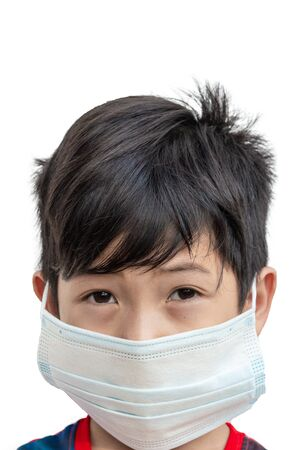 Asia boy wear masks to protect against diseases and virus COVID-19 or Coronavirus treatment concept isolated on a white background Stockfoto