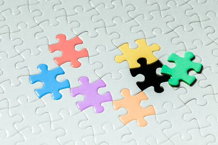 Multicolored Jigsaw puzzle on the background is a  jigsaw puzzle detail object blur art