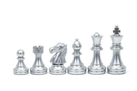 Silver chess piece stand in a row isolated on white background (king, queen, bishop, knight, rook, pawn). Clipping path