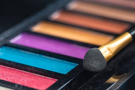 Closeup colorful makeup products detail blur art Stockfoto