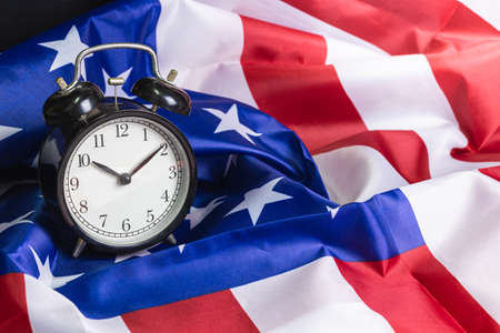 Retro alarm clock on National flag of America background detail art