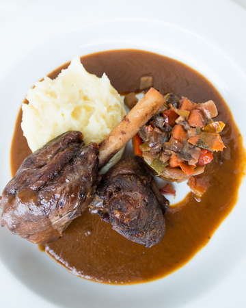 lamb shank: Roast lamb shank with Vegetables and potato paste Stock Photo