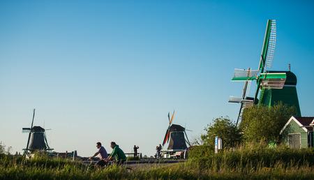 zaandam: Traditional Dutch windmills with canal close Stock Photo