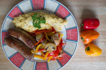german sausage: Omelet with mushrooms and german Sausage