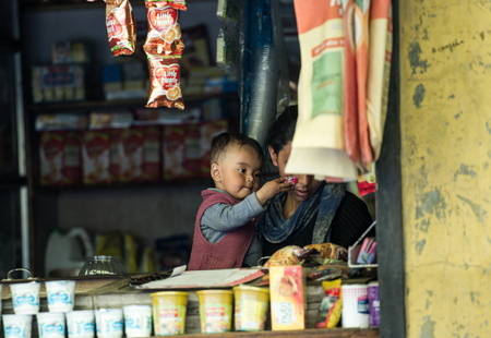 impoverished: Leh Ladakh , India - August 11: Unidentified Children with mom in leh market 10, 2015
