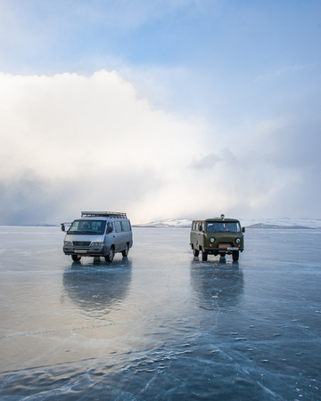 Baikal lake, Russia, March 11, 2016. The Car on the ice of lake Baikal, Russia Editorial